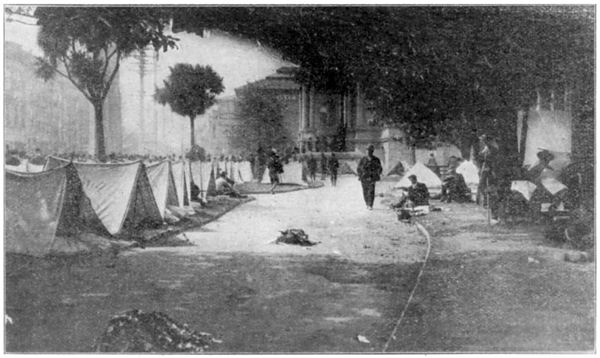 People Living in Tents in a Public Square
