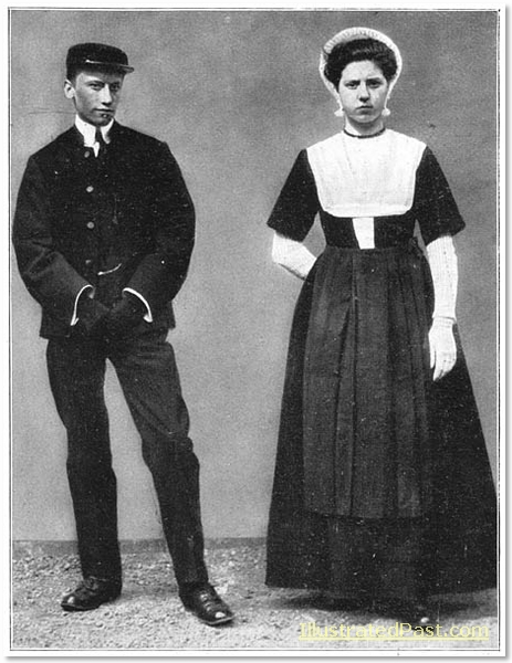 A young man and woman wearing traditional Dutch costume.