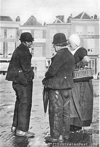 Chatting on a Wet Street in Holland, 1906