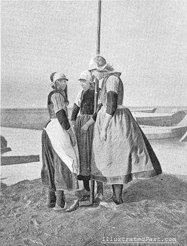 Dutch Girls Perform a Traditional Dance Around a Pole. Is this related to the May Pole?