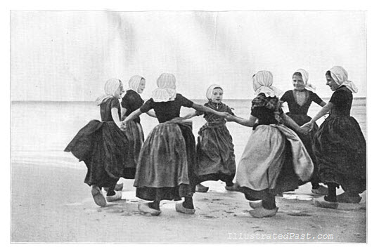 Dutch Girls Doing Traditional Dutch Dance by the Seashore