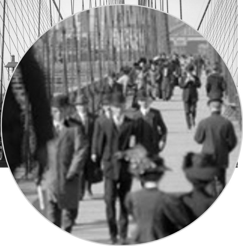 Magnified view of people walking on the Brooklyn Bridge.
