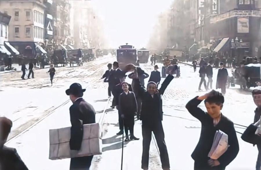 Boys waving to the camera on Market Street, San Francisco1906