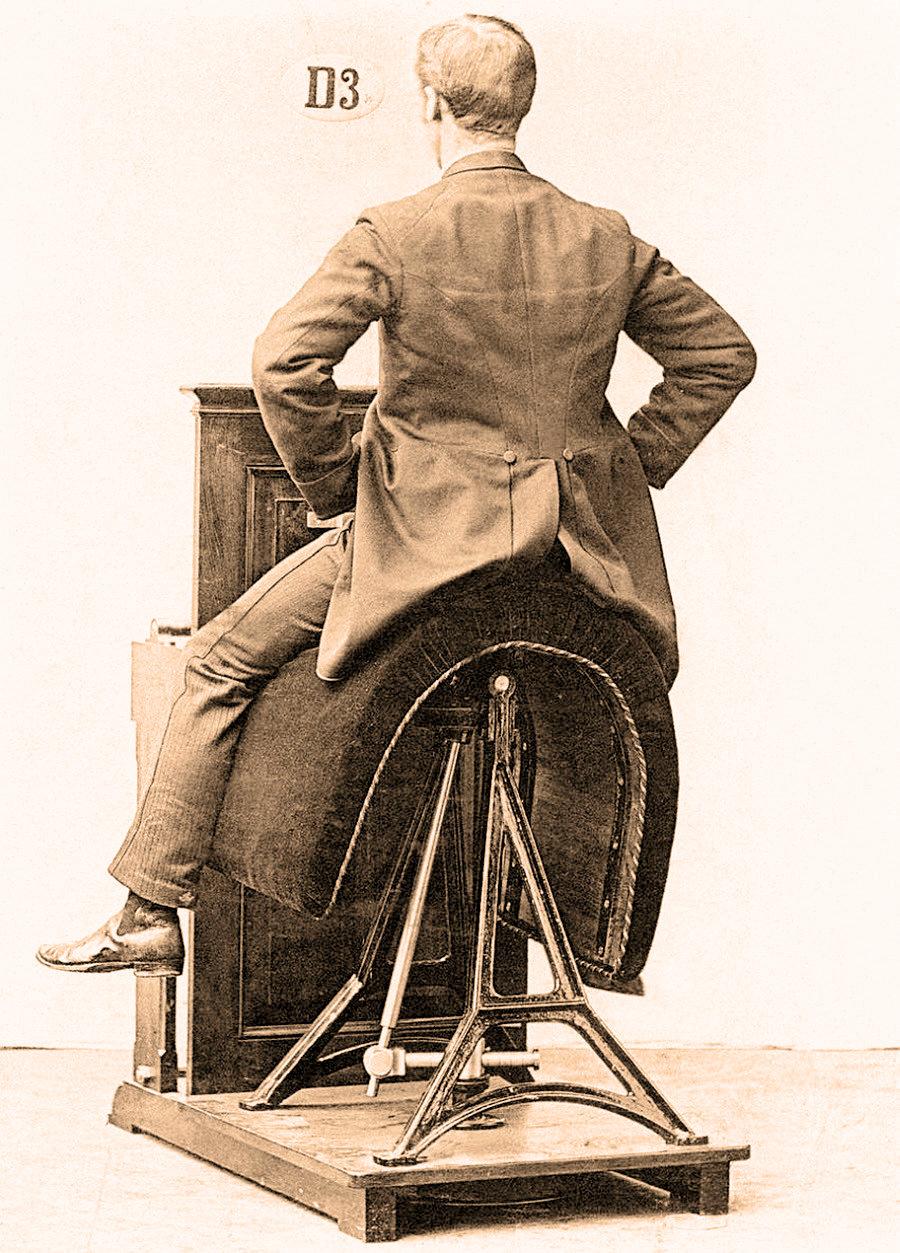 Victorian era gym equipment, Man riding a fitness device to simulate horseback riding