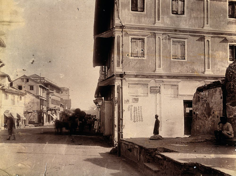 Photograph of a house in Bombay India with plague circles marking the number of deaths