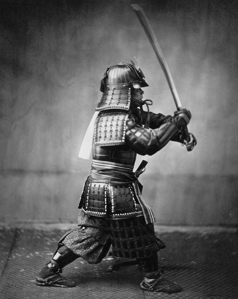 Samurai armed with a sword and wearing armor.
